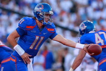 BOISE, ID - SEPTEMBER 25:  Quarterback Kellen Moore #11 of the Boise State Broncos hands off the ball against the Oregon State Beavers at Bronco Stadium on September 25, 2010 in Boise, Idaho.  (Photo by Otto Kitsinger III/Getty Images)