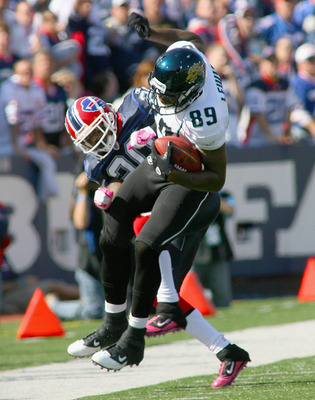 ORCHARD PARK, NY - OCTOBER 10: Marcedes Lewis #89 of the Jacksonville Jaguars is pulled out of bounds by Donte Whitner #20 of the Buffalo Bills at Ralph Wilson Stadium on October 10, 2010 in Orchard Park, New York. Jacksonville won 36-26. (Photo by Rick S