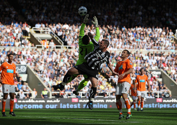NEWCASTLE UPON TYNE, ENGLAND - SEPTEMBER 11:  Blackpool goalkeeper Matthew Gilks saves from Kevin Nolan during the Barclays Premier League match between Newcastle United and Blackpool at St James' Park on September 11, 2010 in Newcastle upon Tyne, England