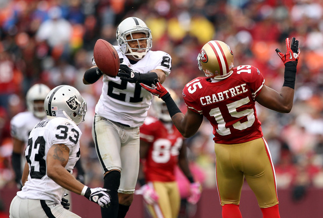 SAN FRANCISCO - OCTOBER 17:  Nnamdi Asomugha  #21 of the Oakland Raiders breaks up a pass intended for Michael Crabtree #15 of the San Francisco 49ers at Candlestick Park on October 17, 2010 in San Francisco, California.  (Photo by Ezra Shaw/Getty Images)