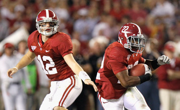 TUSCALOOSA, AL - OCTOBER 16:  Quarterback Greg McElroy #12 of the Alabama Crimson Tide hands the ball off to Mark Ingram #22 against the Ole Miss Rebels at Bryant-Denny Stadium on October 16, 2010 in Tuscaloosa, Alabama.  (Photo by Kevin C. Cox/Getty Imag