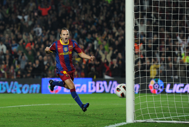 BARCELONA, SPAIN - OCTOBER 16:  Andres Iniesta (L) of Barcelona celebrates scoring his sides equalizing goal during the La Liga match between Barcelona and Valencia at the Camp Nou stadium on October 16, 2010 in Barcelona, Spain. Barcelona won the match 2
