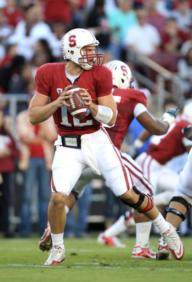 PALO ALTO, CA - OCTOBER 09:  Andrew Luck #12 of the Stanford Cardinal drops back to pass the ball against the USC Trojans at Stanford Stadium on October 9, 2010 in Palo Alto, California.  (Photo by Ezra Shaw/Getty Images)