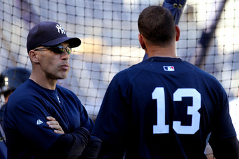 NEW YORK - OCTOBER 13:  Manager Joe Girardi #28 of the New York Yankees talks with Alex Rodriguez #13  during a workout session at Yankee Stadium on October 13, 2010 in the Bronx borough of New York City.  (Photo by Nick Laham/Getty Images)