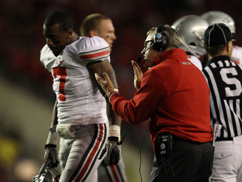MADISON, WI - OCTOBER 16: Head coach Jim Tressel of the Ohio State Buckeyes tries to encourage his team including Jermale Hines #7 against the Wisconsin Badgers at Camp Randall Stadium on October 16, 2010 in Madison, Wisconsin. (Photo by Jonathan Daniel/G
