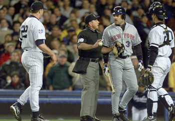 22 Oct 2000:   Mike Piazza of the New York Mets is restrained by home plate umpire Charlie Reliford from pitcher Roger Clemens after Clemens threw his broken bat in his direction in the first inning during Game 2 of the MLB World Series at Yankee Stadium