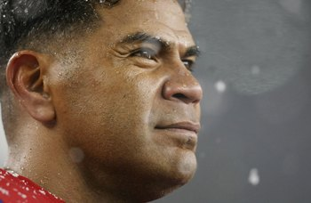 FOXBORO, MA - OCTOBER 18:  Junior Seau #55 of the New England Patriots looks on from the bench in the second half against the Tennessee Titans on October 18, 2009 at Gillette Stadium in Foxboro, Massachusetts.  (Photo by Elsa/Getty Images)