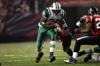 ATLANTA - OCTOBER 24:  Running back Curtis Martin #28 of the New York Jets rushes for yards during a game against the Atlanta Falcons at the Georgia Dome on October 24, 2005 in Atlanta, Georgia.  The Falcons won 27-14.  (Photo by Streeter Lecka/Getty Imag