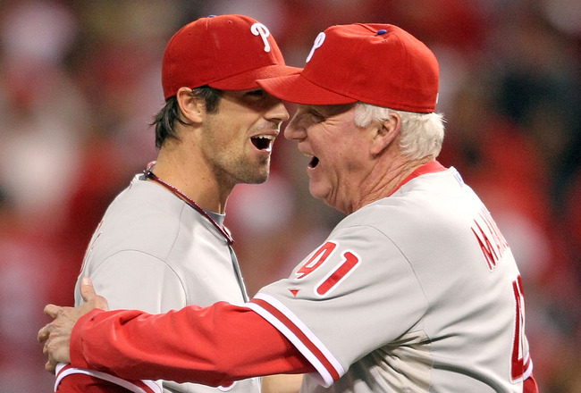 CINCINNATI - OCTOBER 10:  Manager Charlie Manuel #41 of the Philadelphia Phillies hugs pitcher Cole Hamels #35 following a complete game shut-out against the Cincinnati Reds during Game 3 of the NLDS at Great American Ball Park on October 10, 2010 in Cinc