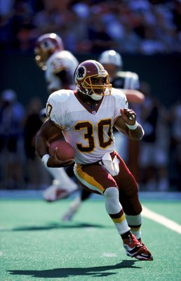 26 Sep 1999:  Brian Mitchell #30 of the Washington Redskins runs with the ball during the game against the New York Jets at the Giants Stadium in East Rutherford, New Jersey. The Redskins defeated the Jets 27-20. Mandatory Credit: Ezra O. Shaw  /Allsport