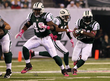 EAST RUTHERFORD, NJ - OCTOBER 11:  Tony Richardson #49 of the New York Jets lead blocks for LaDainian Tomlinson #21 against the Minnesota Vikings at New Meadowlands Stadium on October 11, 2010 in East Rutherford, New Jersey. The Jets won 29-20.  (Photo by