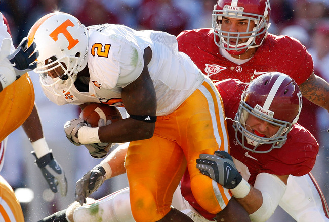 TUSCALOOSA, AL - OCTOBER 24:  Cory Reamer #13 of the Alabama Crimson Tide tackles Montario Hardesty #2 of the Tennessee Volunteers at Bryant-Denny Stadium on October 24, 2009 in Tuscaloosa, Alabama.  (Photo by Kevin C. Cox/Getty Images)