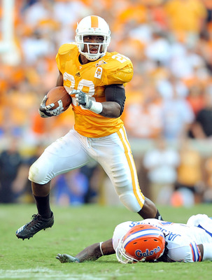KNOXVILLE, TN - SEPTEMBER 18: Tauren Poole #28 of the Tennessee Volunteers breaks away from Janoris Jenkins #1 of the Florida Gators at Neyland Stadium on September 18, 2010 in Knoxville, Tennessee. Florida won 31-17.  (Photo by Grant Halverson/Getty Imag