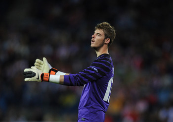 MADRID, SPAIN - SEPTEMBER 30:  Goalkeeper David de Gea of Atletico Madrid reacts during the UEFA Europa League group B match between Atletico Madrid and Bayer 04 Leverkusen at the Vicente Calderon Stadium on September 30, 2010 in Madrid, Spain. The match