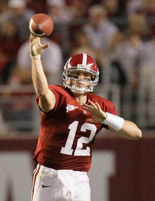 TUSCALOOSA, AL - OCTOBER 16:  Quarterback Greg McElroy #12 of the Alabama Crimson Tide passes upfield against the Ole Miss Rebels at Bryant-Denny Stadium on October 16, 2010 in Tuscaloosa, Alabama.  (Photo by Kevin C. Cox/Getty Images)