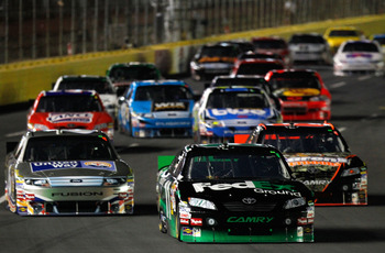 CONCORD, NC - OCTOBER 16: Denny Hamlin, driver of the #11 FedEx Ground Toyota, leads a group of cars during the NASCAR Sprint Cup Series Bank of America 500 at Charlotte Motor Speedway on October 16, 2010 in Concord, North Carolina.  (Photo by Geoff Burke