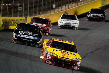 CONCORD, NC - OCTOBER 16:  Kevin Harvick, driver of the #29 Shell/Pennzoil Chevrolet, leads a group of cars during the NASCAR Sprint Cup Series Bank of America 500 at Charlotte Motor Speedway on October 16, 2010 in Concord, North Carolina.  (Photo by Geof
