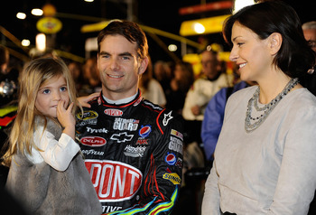 CONCORD, NC - OCTOBER 16:  Jeff Gordon (C), driver of the #24 DuPont Chevrolet, talks with daughter Ella Sophia (L) and wife Ingrid Vandebosch (R) on the grid prior to the NASCAR Sprint Cup Series Bank of America 500 at Charlotte Motor Speedway on October