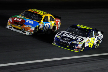 CONCORD, NC - OCTOBER 16:  Kyle Busch, driver of the #18 M&M's Toyota, races Jimmie Johnson, driver of the #48 Lowe's Chevrolet, during the NASCAR Sprint Cup Series Bank of America 500 at Charlotte Motor Speedway on October 16, 2010 in Concord, North Caro
