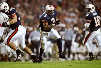 22 Nov 1997:  Tailback Rusty Williams of the Auburn Tigers (center) runs past quarterback Dameyune Craig (right) during a game against the Alabama Crimson Tide at the Jordan-Hare Stadium in Auburn, Alabama.  Auburn won the game 18-17. Mandatory Credit: An