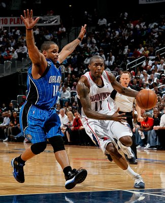 ATLANTA - MAY 10:  Jameer Nelson #14 of the Orlando Magic against Jamal Crawford #11 of the Atlanta Hawks during Game Four of the Eastern Conference Semifinals of the 2010 NBA Playoffs at Philips Arena on May 10, 2010 in Atlanta, Georgia.  NOTE TO USER: U