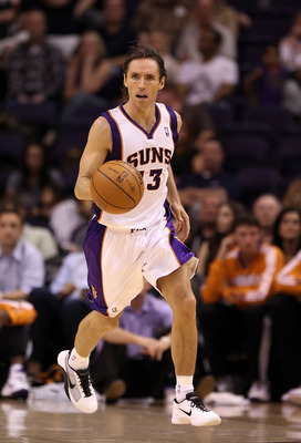 PHOENIX - OCTOBER 12:  Steve Nash #13 of the Phoenix Suns handles the ball during the preseason NBA game against the Utah Jazz at US Airways Center on October 12, 2010 in Phoenix, Arizona. NOTE TO USER: User expressly acknowledges and agrees that, by down