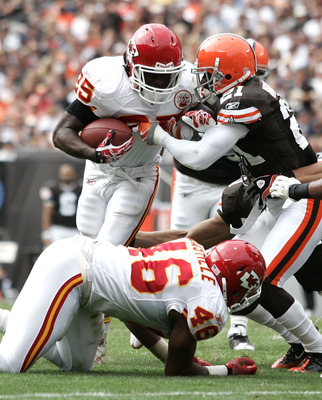 CLEVELAND - SEPTEMBER 19:  Running back Jamaal Charles #25 of the Kansas City Chiefs runs by defensive back Eric Wright #21 of the Cleveland Browns at Cleveland Browns Stadium on September 19, 2010 in Cleveland, Ohio.  (Photo by Matt Sullivan/Getty Images
