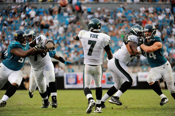 JACKSONVILLE, FL - SEPTEMBER 26:  Quarterback Michael Vick #7 of the Philadelphia Eagles throws a pass while under pressure against the Jacksonville Jaguars at EverBank Field on September 26, 2010 in Jacksonville, Florida. The Eagles defeated the Jaguars