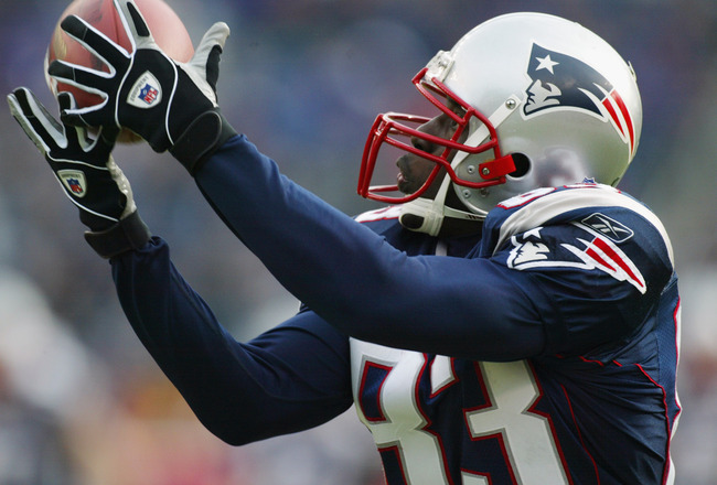 FOXBORO, MA - DECEMBER 8:  Deion Branch #83 of the New England Patriots catches a pass from Tom Brady against the Buffalo Bills during the NFL game on December 8, 2002 at Gillette Stadium in Foxboro, Massachusetts.  The Patriots defeated the Bills 27-17.