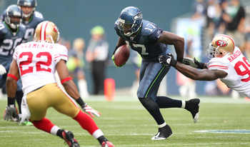 SEATTLE - SEPTEMBER 12:  Wide receiver Mike Williams #17 of the Seattle Seahawks rushes against Parys Haralson #98 of the San Francisco 49ers during the NFL season opener at Qwest Field on September 12, 2010 in Seattle, Washington. (Photo by Otto Greule J