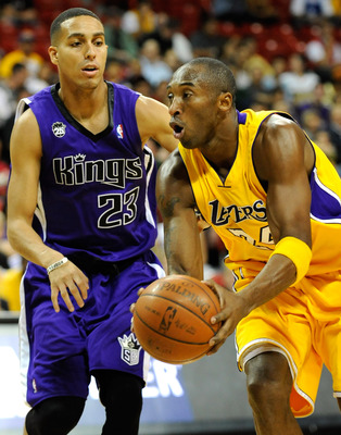 LAS VEGAS - OCTOBER 15:  Kobe Bryant #24 of the Los Angeles Lakers drives around Kevin Martin #23 of the Sacramento Kings during their preseason game at the Thomas & Mack Center October 15, 2009 in Las Vegas, Nevada. NOTE TO USER: User expressly acknowled