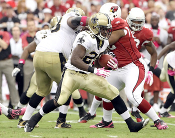 GLENDALE, AZ - OCTOBER 10:  Runningback Chris Ivory #29 of the New Orleans Saints runs with the football against the Arizona Cardinals during the NFL game at the University of Phoenix Stadium on October 10, 2010 in Glendale, Arizona. The Cardinals defeate