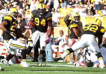 PITTSBURGH - OCTOBER 17:  Lawrence Timmons #94 of the Pittsburgh Steelers runs with the ball after catching an interception against the Cleveland Browns during the game on October 17, 2010 at Heinz Field in Pittsburgh, Pennsylvania.  (Photo by Jared Wicke