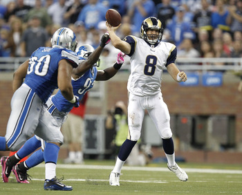 DETROIT - OCTOBER 10: Sam Bradford #8 of the St. Louis Rams tries to get a pass of before being tackled by Cliff Avril #92 and Ndamukong Suh #90 of the Detroit Lions on October 10, 2010 at Ford Field in Detroit, Michigan. Detroit won the game 44-6. (Photo