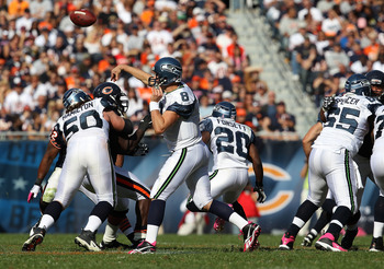 CHICAGO - OCTOBER 17: Matt Hasselbeck #8 of the Seattle Seahawks passes the ball against the Chicago Bears as teammates Ben Hamilton #50 and Chris Spencer #65 block at Soldier Field on October 17, 2010 in Chicago, Illinois. The Seahawks defeated the Bears