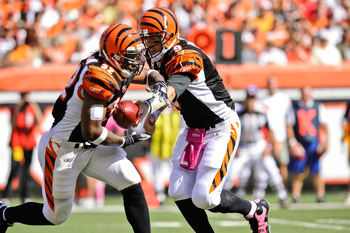 CINCINNATI, OH - OCTOBER 10: Quarterback Carson Palmer #9 of the Cincinnati Bengals hands off to Cedric Benson #32 of the Bengals during a game against the Tampa Bay Buccaneers at Paul Brown Stadium on October 10, 2010 in Cincinnati, Ohio. (Photo by Jamie