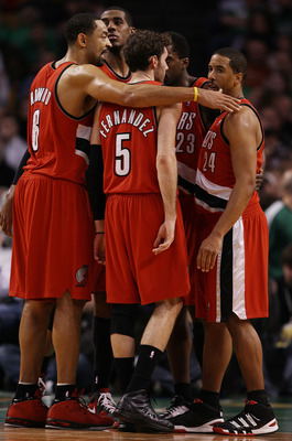 BOSTON - JANUARY 22:  Juwan Howard #6 of the Portland Trailblazers gathers teammates Rudy Fernandez #5 and Andre Miller #24 together during a break in play in the second half against the Boston Celtics at the TD Garden on January 22, 2010 in Boston, Massa