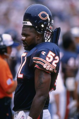 11 Aug 1996:  Linebacker Bryan Cox of the Chicago Bears takes an opportunity to rest on the sideline during an offensive series in the Bears 24-21 victory over the Miami Dolphins at Soldier Field in Chicago, Illinois.  Mandatory Credit: Jonathan Daniel  /