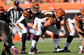 CINCINNATI, OH - OCTOBER 10: Quarterback Carson Palmer #9 of the Cincinnati Bengals takes the snap from center Kyle Cook #64 of the Cincinnati Bengals against the Tampa Bay Buccaneers at Paul Brown Stadium on October 10, 2010 in Cincinnati, Ohio. (Photo b