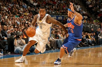 DENVER - JANUARY 08:  J.R. Smith #5 of the Denver Nuggets dribbles the ball against Delonte West #13 of the Cleveland Cavaliers during NBA action at Pepsi Center on January 8, 2010 in Denver, Colorado. The Nuggets defeated the Cavaliers 99-97. NOTE TO USE