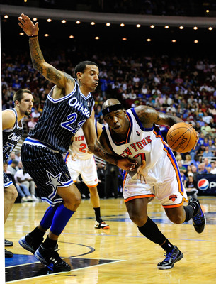 ORLANDO, FL - DECEMBER 02:  Al Harrington #7 of the New York Knicks drives against Matt Barnes #22 of the Orlando Magic during the game at Amway Arena on December 2, 2009 in Orlando, Florida.  NOTE TO USER: User expressly acknowledges and agrees that, by