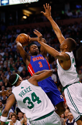 BOSTON - MAY 28:  Rodney Stuckey #3 of the Detroit Pistons shoots over P.J. Brown #93 and Paul Pierce #34 of the Boston Celtics during Game Five of the Eastern Conference finals during the 2008 NBA Playoffs at TD Banknorth Garden on May 28, 2008 in Boston