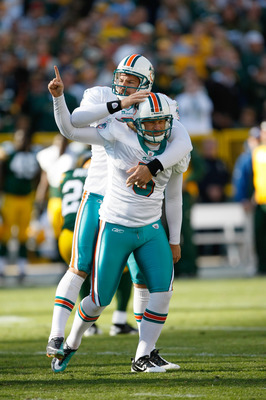 GREEN BAY, WI - OCTOBER 17: Dan Carpenter #5 and Brandon Fields #2 of the Miami Dolphins celebrate the winning field goal in overtime against the Green Bay Packers at Lambeau Field on October 17, 2010 in Green Bay, Wisconsin. The Dolphins defeated the Pac