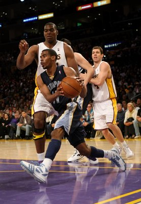 LOS ANGELES - APRIL 12:   Mike Conley #11 of the Memphis Grizzliesdrives around Andrew Bynum #17 of the Los Angeles Lakers on April 12, 2009 at Staples Center in Los Angeles, California.  The Lakers won 92-75.  NOTE TO USER: User expressly acknowledges an
