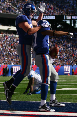 EAST RUTHERFORD, NJ - OCTOBER 17:  Kevin Boss #89 (R) and Travis Beckum #47 of the New York Giants celebrate after Beckum's third quarter touch down against the Detroit Lions at New Meadowlands Stadium on October 17, 2010 in East Rutherford, New Jersey.