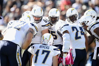 OAKLAND, CA - OCTOBER 10:  Philip Rivers #17 of the San Diego Chargers huddles his team together during their game against the Oakland Raiders at Oakland-Alameda County Coliseum on October 10, 2010 in Oakland, California.  (Photo by Ezra Shaw/Getty Images