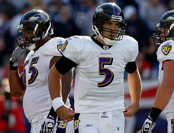 FOXBORO, MA - OCTOBER 17:  Joe Flacco #5 of the Baltimore Ravens takes a breather against the New England Patriots during a game at  at Gillette Stadium on October 17, 2010 in Foxboro, Massachusetts. (Photo by Jim Rogash/Getty Images)