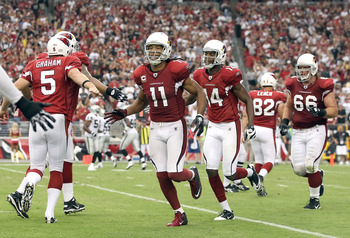 GLENDALE, AZ - SEPTEMBER 26:  Wide receiver Larry Fitzgerald #11 of the Arizona Cardinals celebrates with teammates after scoring on a 8 yard touchdown reception against the Oakland Raiders during the thrid quarter of the NFL game at the University of Pho