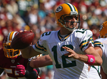 LANDOVER, MD - OCTOBER 10: Quarterback Aaron Rodgers #12 of the Green Bay Packers drops back to pass against the Washington Redskins at FedExField on October 10, 2010 in Landover, Maryland.  (Photo by Win McNamee/Getty Images)