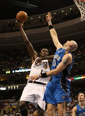 PHILADELPHIA - APRIL 30:  Samuel Dalembert #1 of the Philadelphia 76ers shoots over Marcin Gortat #13 of the Orlando Magic during Game Six of the Eastern Conference Quarterfinals at Wachovia Center on April 30, 2009 in Philadelphia, Pennsylvania. NOTE TO